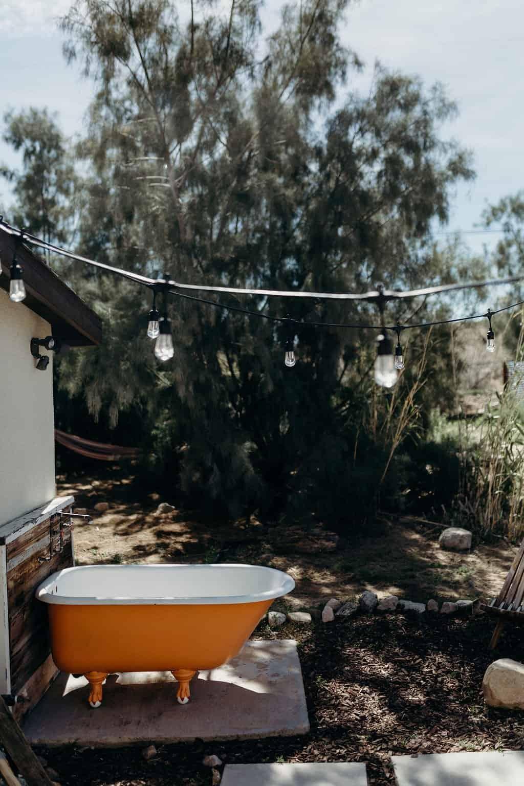Orange clawfoot tub outside a Joshua Tree airbnb