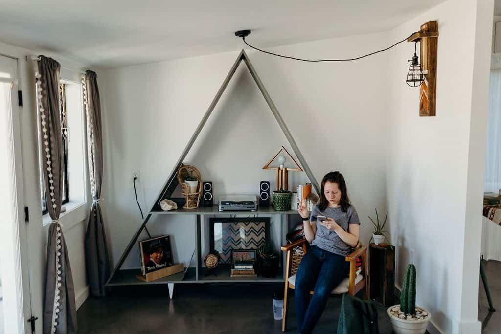woman sitting in Joshua Tree airbnb