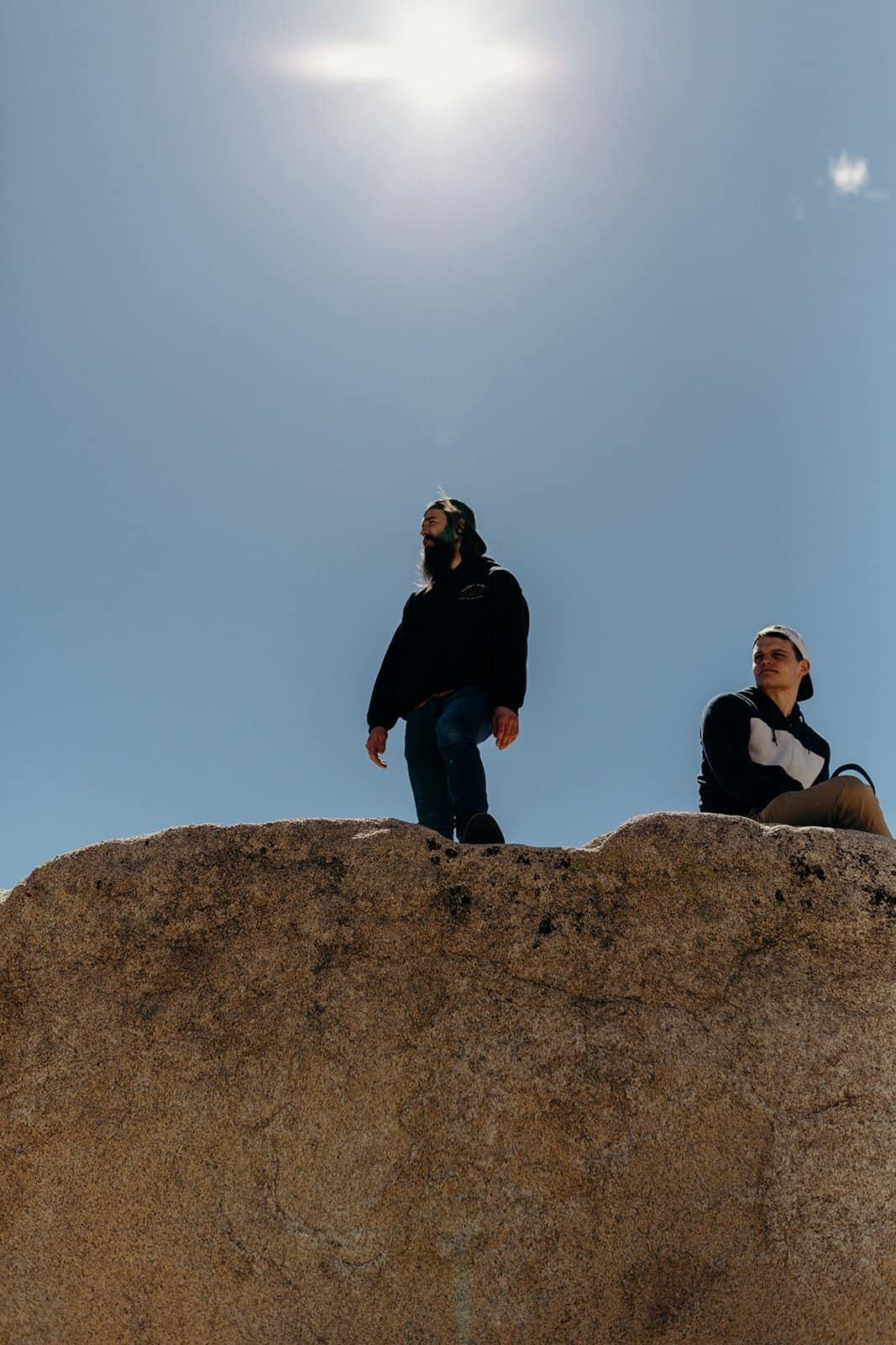 Men on boulder in Joshua Tree National Park