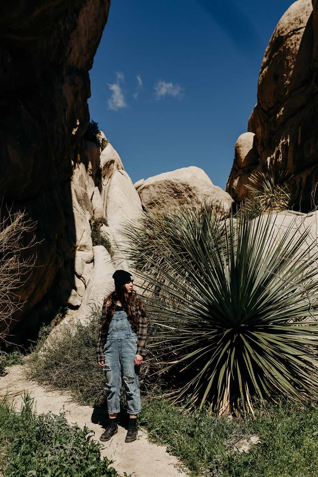 woman posing in from of plant in Joshua Tree National Park