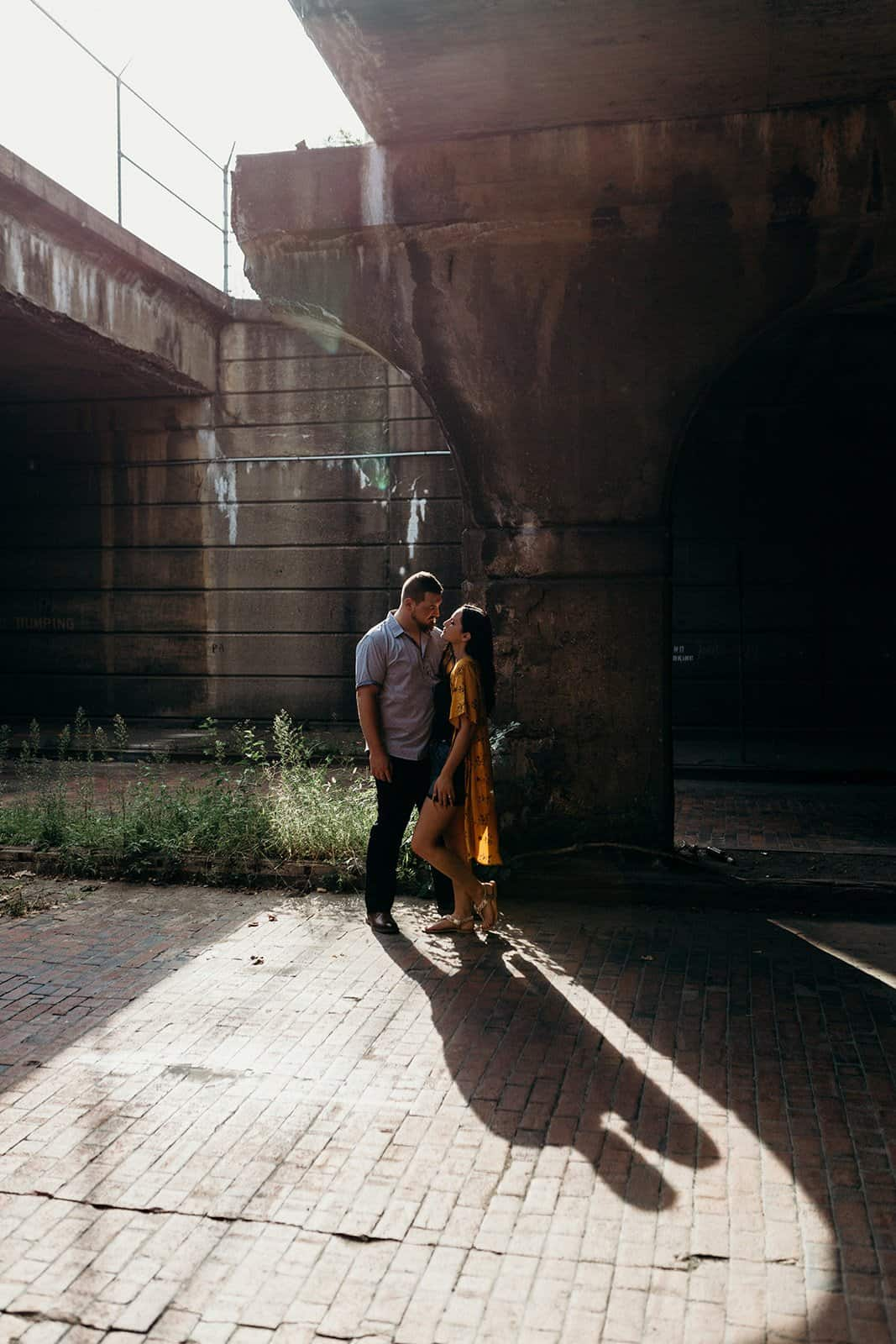 couple gazing at each other at underpass in Pittsburgh
