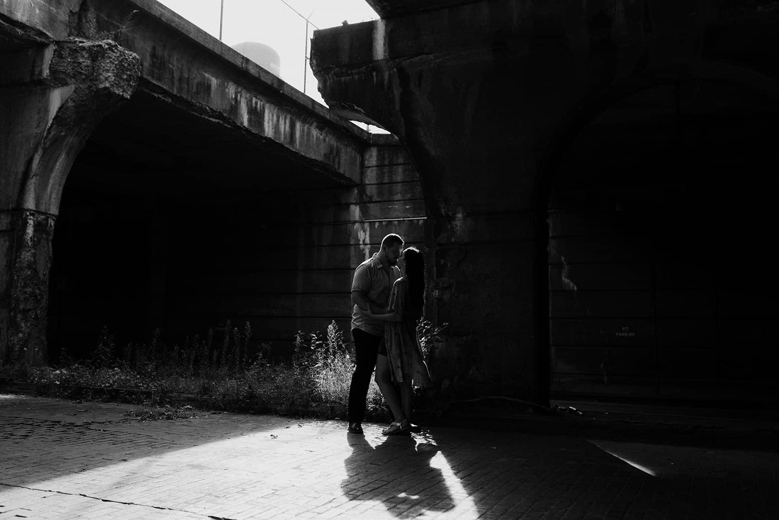 couple embracing at underpass in Pittsburgh