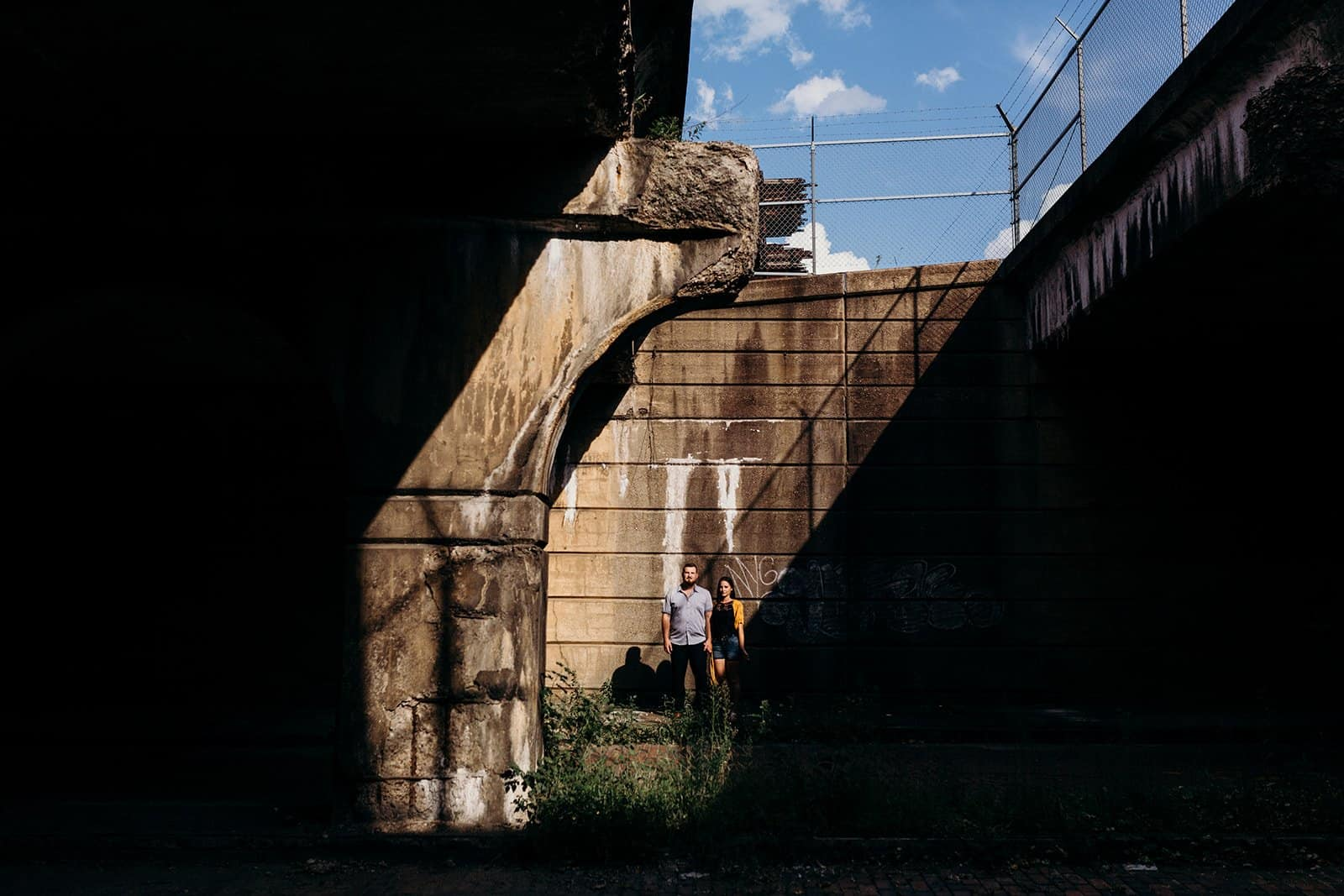 couple standing in distance at underpass in Pittsburgh