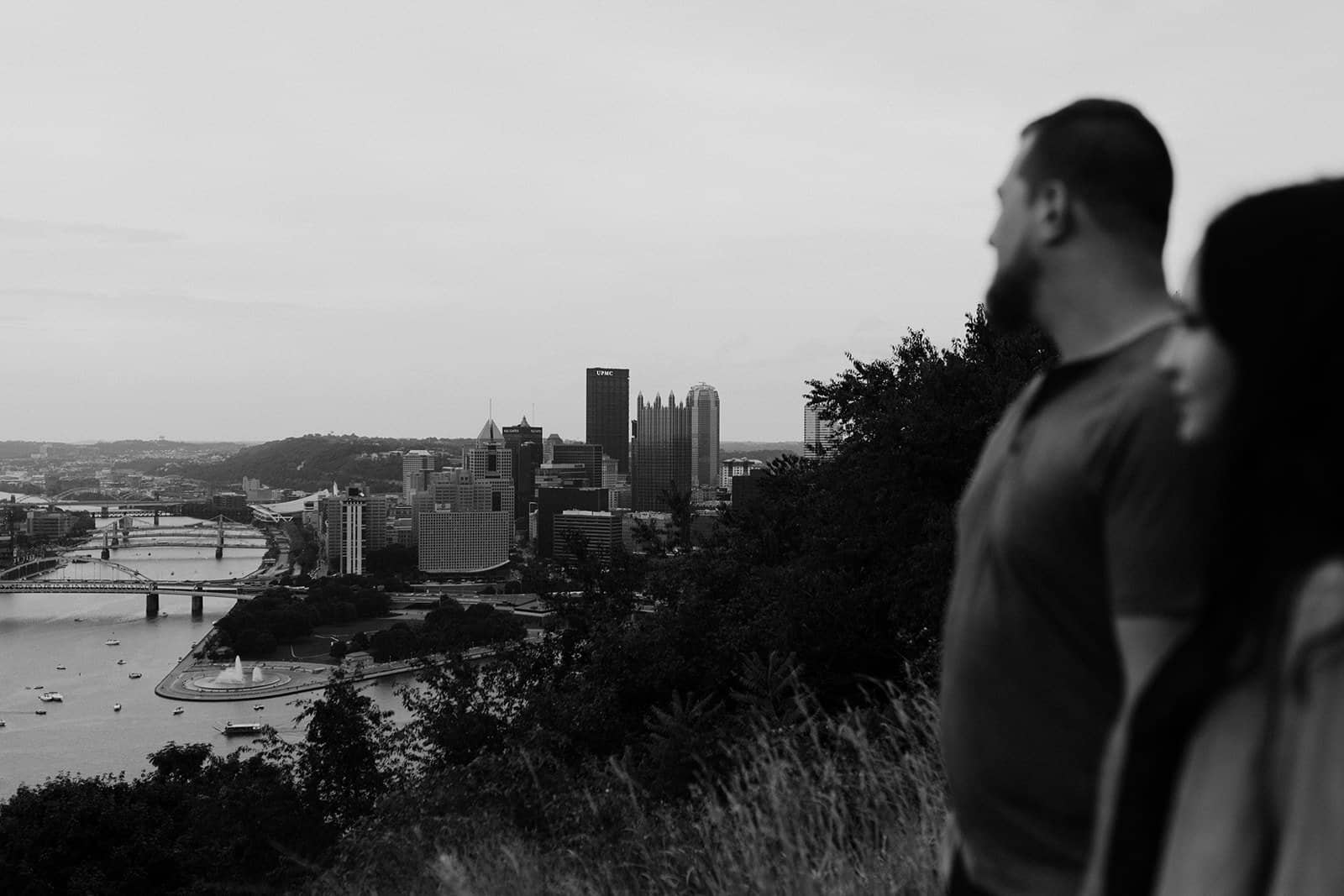 horizon shot of downtown Pittsburgh with blurry couple looking in distance