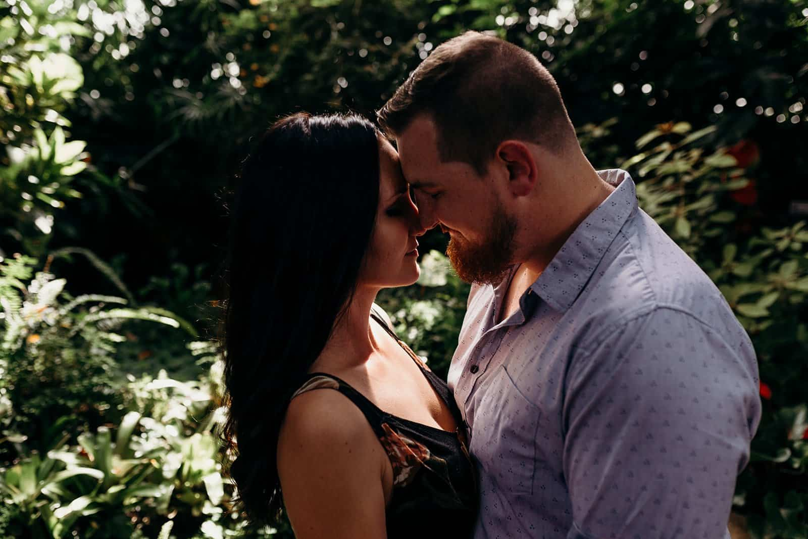 Couple pressing foreheads together at Phipps Conservatory engagement session