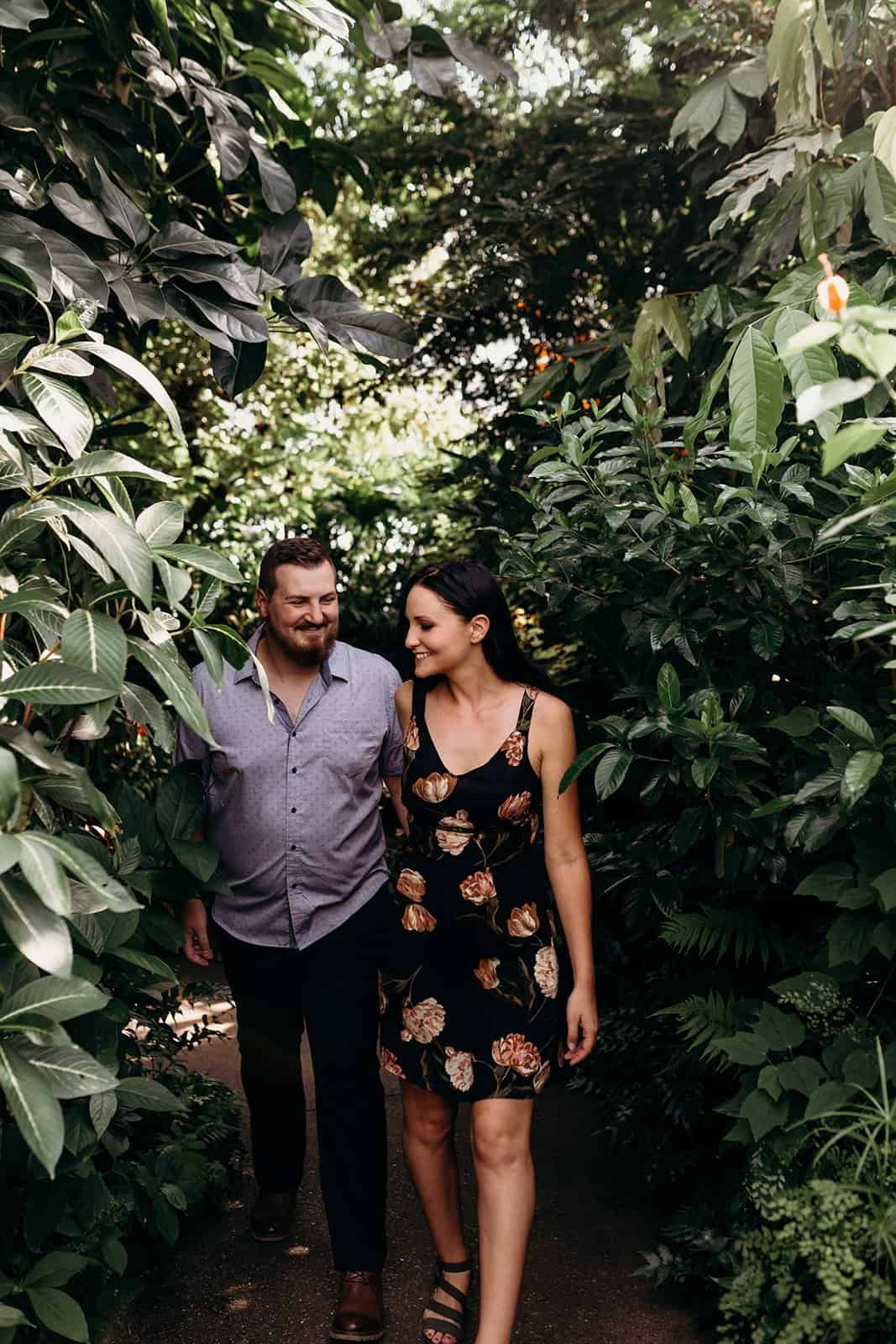 couple walking through plants at Phipps Conservatory