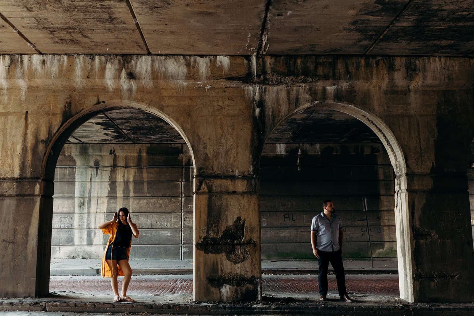 couple voguing between pillars at underpass in pittsburgh